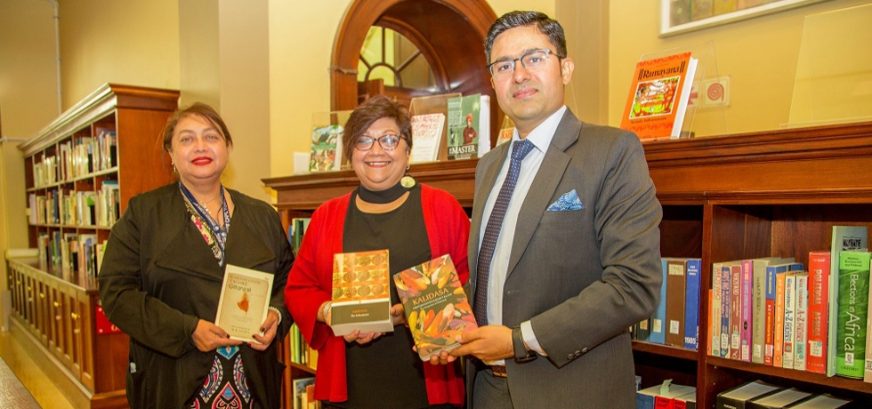 Consul General Abhishek Shukla presenting set of books for 'India Corner' in UCT Library